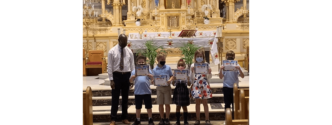students on altar with certificates