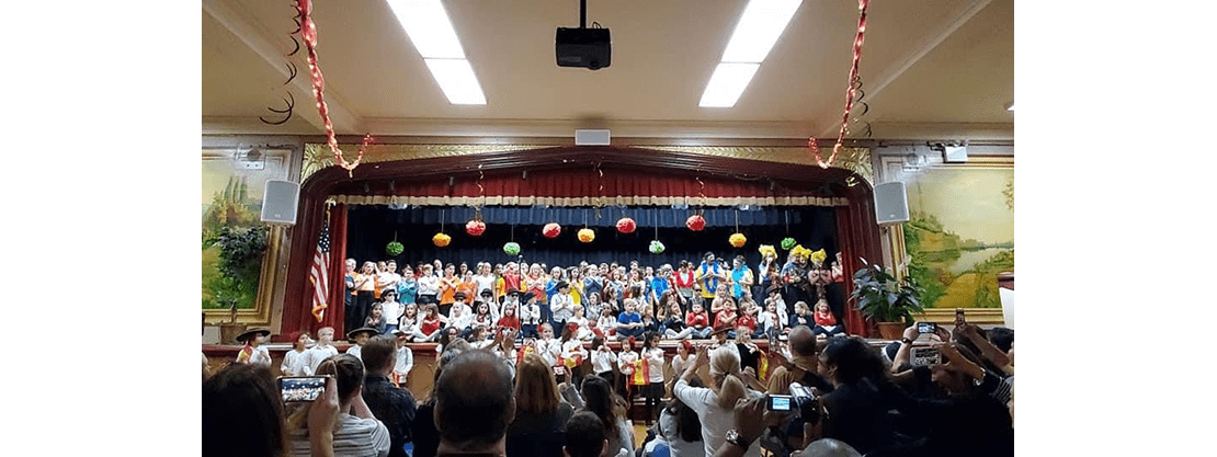 students on stage for school show