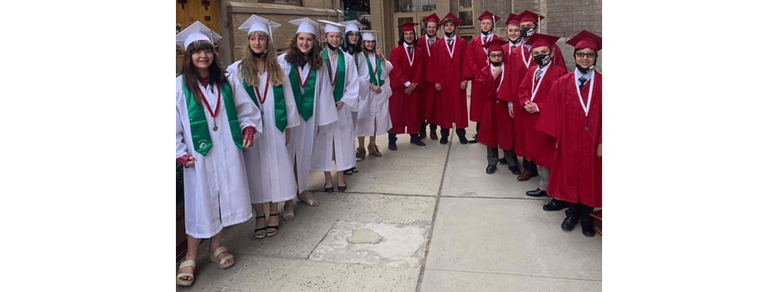 8th grade graduates in caps and gowns